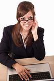 Attractive twenties caucasian business woman. Attractive brunette caucasian business woman in her twenties working on laptop Stock Images
