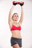 Attractive twenties caucasian fitness woman. Lifting weights Royalty Free Stock Image
