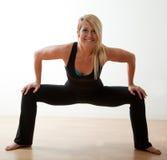 Attractive twenties caucasian woman exercising Stock Photography