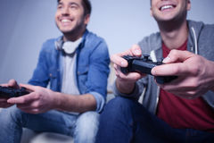 Attractive two guys are playing video games Stock Image