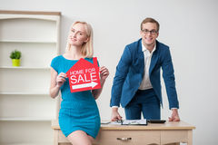 Attractive two realtors are advertising their Stock Images