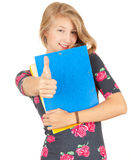 Attractive university student girl with thumb up Stock Photos