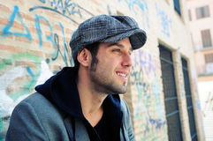 Attractive urban man wearing a retro cap Stock Image