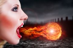 Attractive vampire with magic. In an apocalyptic scenario Stock Photos