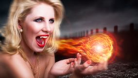 Attractive vampire / witch. With a fireball Stock Photo