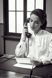 Attractive vintage secretary on the phone Stock Photography