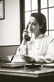 Attractive vintage secretary on the phone Royalty Free Stock Images