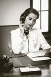 Attractive vintage secretary on the phone royalty free stock image