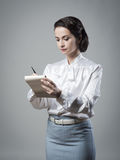Attractive vintage secretary taking notes Royalty Free Stock Images