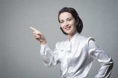 Attractive vintage woman pointing up Royalty Free Stock Photo