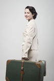 Attractive vintage woman with suitcases Royalty Free Stock Images