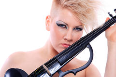 Attractive violinist playing the electric violin Stock Photo