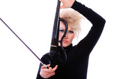 Attractive violinist playing the electric violin Stock Image