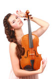 Attractive violinist posing with violin Stock Images