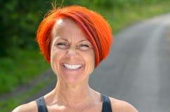 Attractive vivacious redhead woman Stock Photo