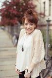 Attractive vivacious young woman Stock Image