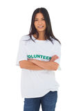 Attractive volunteer with arms crossed Stock Photography