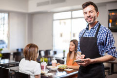 Attractive waiter ready to take your order Stock Photo