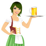 Attractive waitress holding tray with beer mug for oktoberfest party wearing a dirndl Stock Image