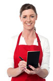 Attractive waitress taking order Stock Photo