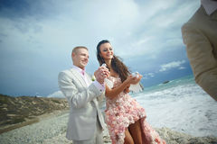 Attractive wedding couple letting go white doves at beautiful ce Royalty Free Stock Photos