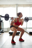 Attractive weight-lifter Stock Images