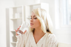 Attractive well-being girl drinking water in the morning Stock Photography