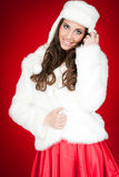 Attractive winter woman in costume posing Royalty Free Stock Photography