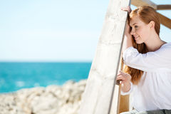 Attractive woman admiring the sea Royalty Free Stock Images