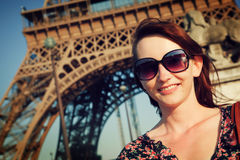 Attractive woman against Eiffel Tower Stock Photography