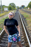 The attractive woman against railway tracks Stock Images