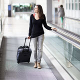 Attractive woman at the airport Royalty Free Stock Photo