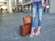Attractive woman at the airport with retro vintage luggage. In h Royalty Free Stock Images