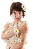 Attractive woman with allergy as chrysanthemum flowers on body Stock Photos