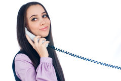 Attractive woman answering phone and smiling Royalty Free Stock Photo