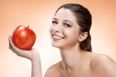 Attractive woman with apple Royalty Free Stock Images