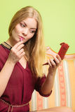 Attractive woman applying lipstick. Make up. Royalty Free Stock Images