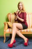 Attractive woman applying lipstick. Make up. Stock Photos