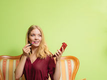 Attractive woman applying lipstick. Make up. Royalty Free Stock Photo