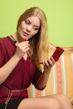 Attractive woman applying lipstick. Make up. Royalty Free Stock Photography
