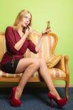 Attractive woman applying lipstick. Make up. Stock Photo