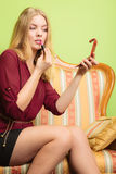 Attractive woman applying lipstick. Make up. Stock Image