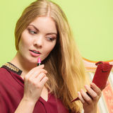 Attractive woman applying lipstick. Make up. Young attractive woman applying pink lipstick on lips. Pretty gorgeous girl beautifying. Make up Royalty Free Stock Photos