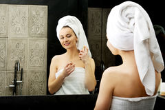 Attractive woman applying parfume. Royalty Free Stock Images