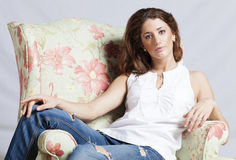 Attractive woman in the armchair Royalty Free Stock Photos