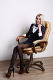 Attractive woman in armchair Royalty Free Stock Image