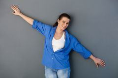 Attractive woman with arms wide open Stock Photos