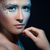 Attractive woman with artistic make-up Stock Photo