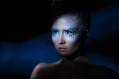 Attractive woman with artistic make-up Royalty Free Stock Image
