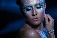 Attractive woman with artistic make-up Royalty Free Stock Images